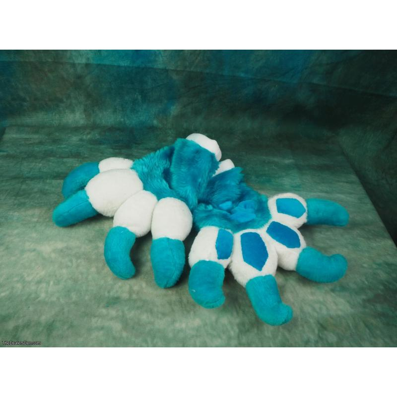 Turquoise and white furry tail and paws